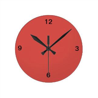 Reloj de pared rojo de Pimienta