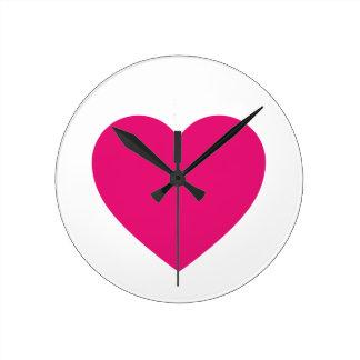 Reloj de pared rosado del corazón