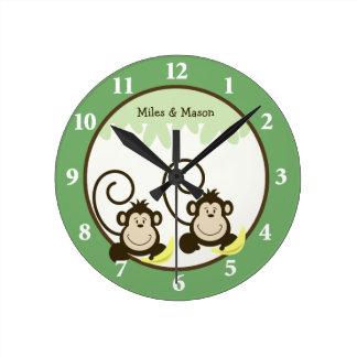 Reloj de pared tonto de los gemelos de los monos -