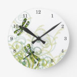 Reloj de pared verde de las libélulas