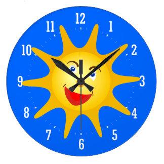 Reloj decorativo del sol feliz