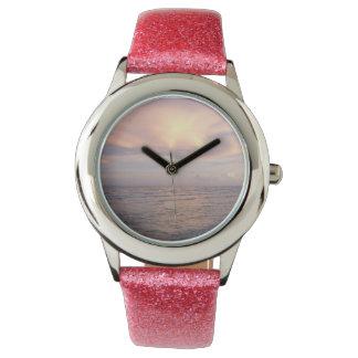 Reloj del brillo del rosa de la puesta del sol de