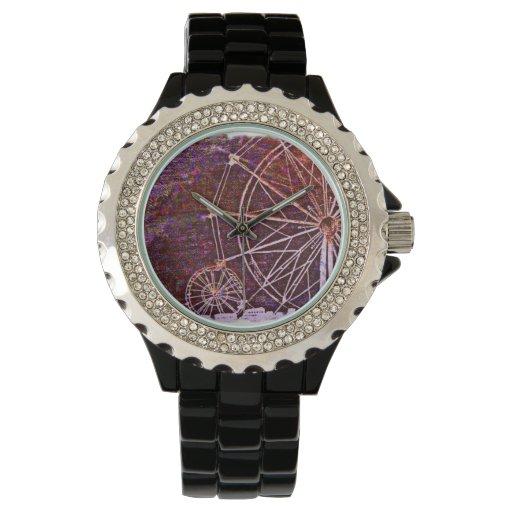 Reloj del carnaval que ofrece una noria