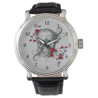 Reloj del cráneo de los rosas rojos