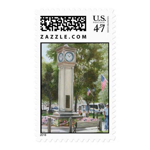 Reloj del lux en el verde sello postal