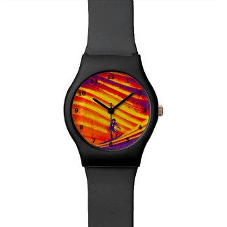 Reloj, diseño abstracto de la puesta del sol