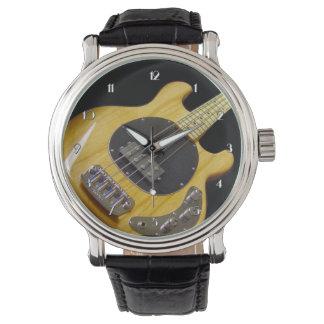 Reloj eléctrico de la guitarra baja