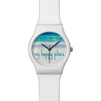 Reloj feliz de la playa del océano del lugar