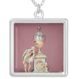 Reloj-funda, mármol y ormolu de Venus Pendientes