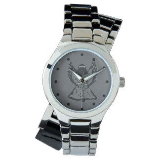Reloj gris de la plata del ángel
