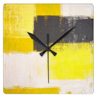 Reloj gris y amarillo del arte abstracto