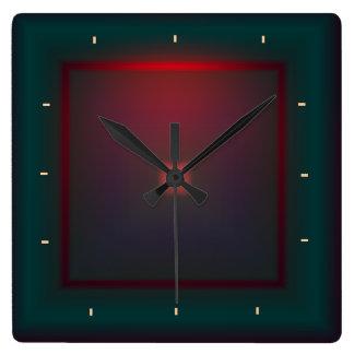 Reloj iluminado del verde y de Red>Wall