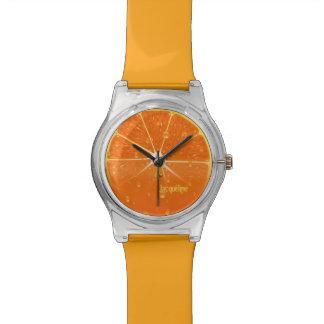 Reloj jugoso anaranjado del jugo