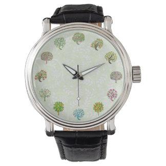 Reloj lindo del jardinero del diseño del árbol