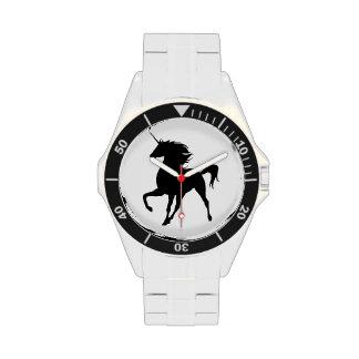 Reloj negro de la silueta del unicornio