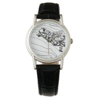 Reloj negro y blanco del gráfico del guepardo