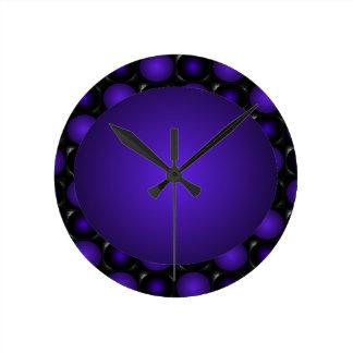 Reloj purpurino y púrpura de la bola del diseño 3D