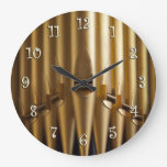 Reloj redondo de los tubos de órgano