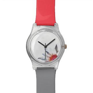 Reloj rojo con el extracto de Waterlily