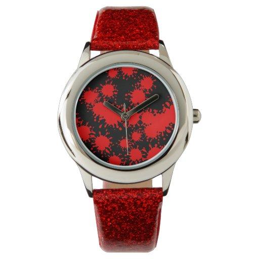 Reloj rojo de la pintura del chapoteo