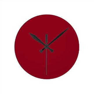 Reloj rojo marrón