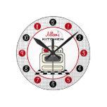 Reloj rojo y negro de la estufa retra de la cocina