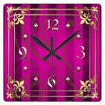 Reloj rosado afiligranado de la raya del oro real
