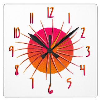 Reloj rosado anaranjado del resplandor solar