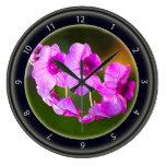 Reloj rosado de la orquídea