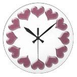 Reloj rosado de los corazones