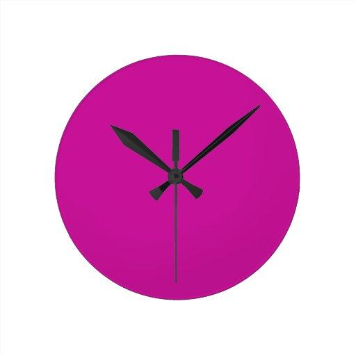 Reloj rosado de neón caliente