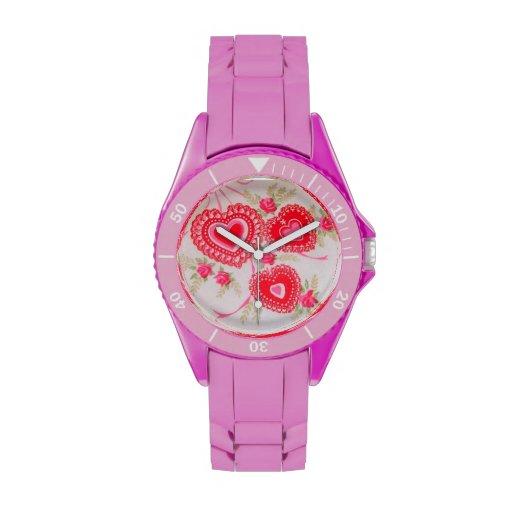 Reloj rosado del diseño de la imagen de los capull