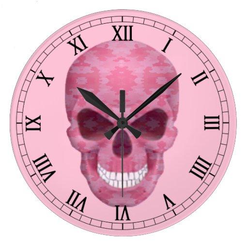 Reloj rosado del número romano del cráneo del
