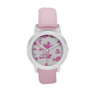 Reloj rosado del unicornio de Toile