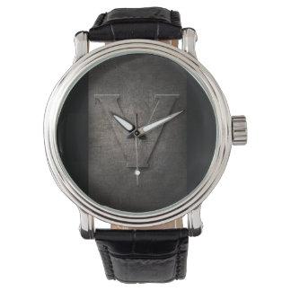 Reloj rústico del monograma del metal negro V