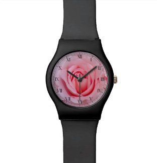 Reloj soñador del rosa