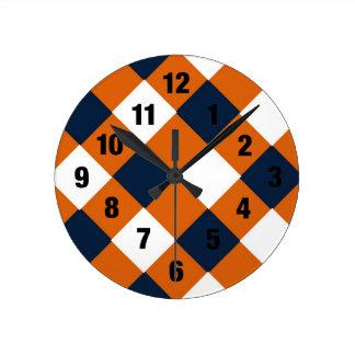 Reloj tímido del zapatero del naranja y del azul