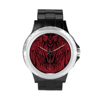 Reloj tribal rojo
