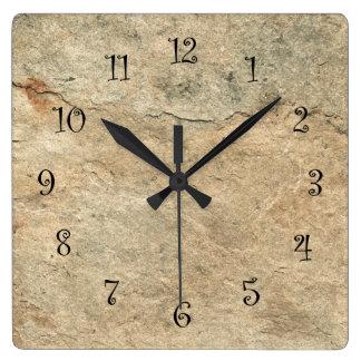 Relojes de pared de piedra de la cocina de la mira