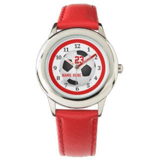 Relojes rojos del fútbol de los niños para los