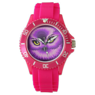 Relojes rosados de los ojos del búho