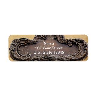 Remite antiguo de la placa del pergamino y del lat etiqueta de remite