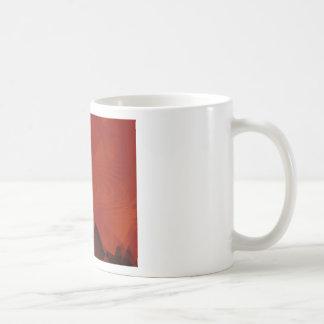 Remolino dentado del naranja taza de café