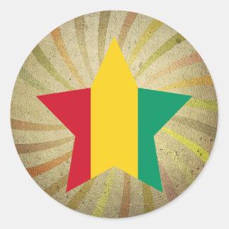 Remolino guineano de la bandera del vintage pegatina redonda