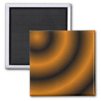Remolino redondo anaranjado y negro imán cuadrado