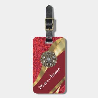 Remolino rojo del damasco y del oro etiqueta para maleta