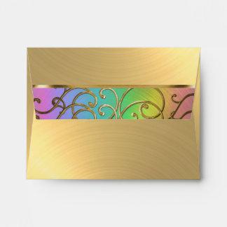 Remolinos afiligranados del arco iris y del oro de sobre