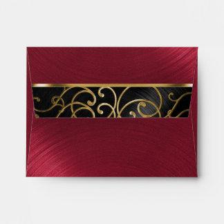 Remolinos afiligranados del oro rojo negro de sobres