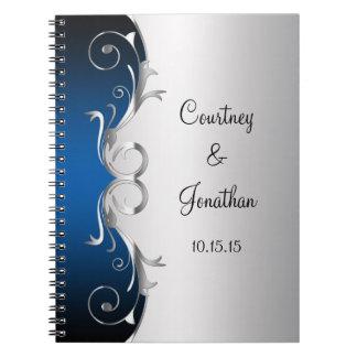 Remolinos de plata azules y adornados que casan el note book