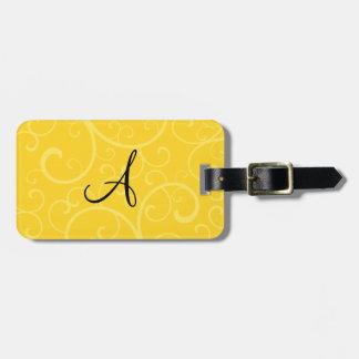 Remolinos del amarillo del monograma etiquetas para maletas